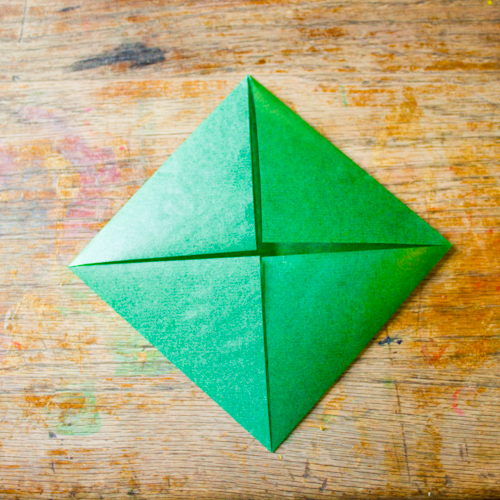 Fold each corner in to make a triangle