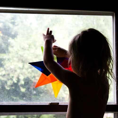 Here's how to make a Waldorf star: a kid-friendly, plastic-free suncatcher. Stick it onto any sunny window, and watch it glow.