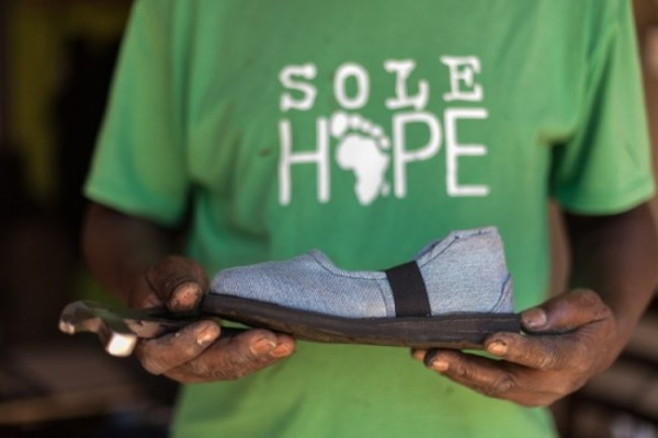 I know that we love to turn our old jeans into quilts and skirts and potholders and tote bags, but the organization Sole Hope has an even better use for them: They save kids' lives.