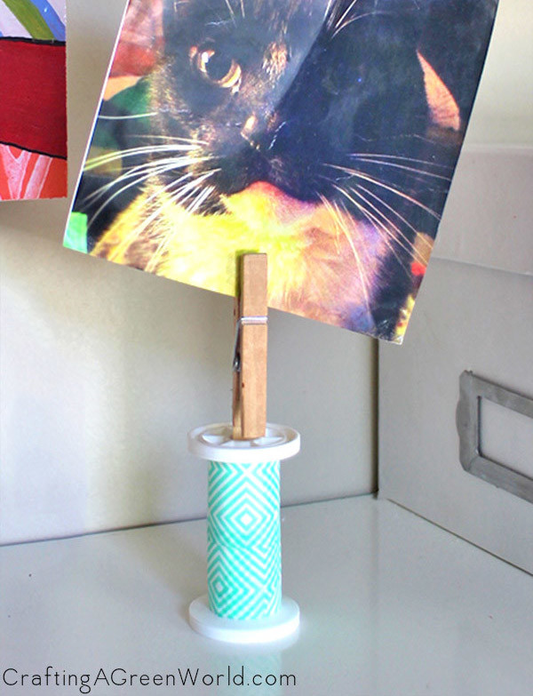Make a DIY picture holder from a spent spool of thread!