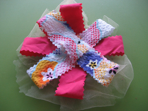 Make a sweet, fabric bouquet from your stash of fabric scraps. They're a cute decoration for your house or as a gift.
