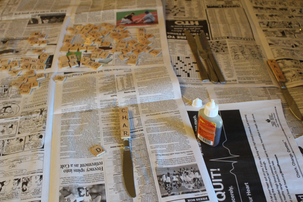 scrabble letters on newspaper
